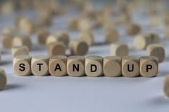 Stand up - cube with letters, sign with wooden cubes royalty free stock photography