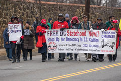 Stand Up for Democracy. Washington, DC - January 16, 2017: People holding signs advocating for statehood for the District of Columbia march in the Martin Luther stock photos
