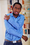 Stand up man holding his shoulder with his hands and pain face expression Royalty Free Stock Images