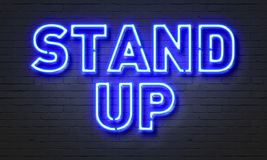 Stand Up Neon Sign On Brick Wall Background. Royalty Free Stock Photography