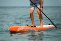 Stand up paddle board man paddleboarding Royalty Free Stock Images