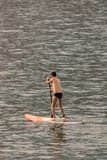 Stand up paddle board man paddleboarding . Young caucasian male model on Copacabana beach on summer holidays vacation trave royalty free stock photography