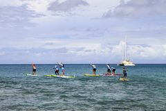 Stand up paddle board race on US Virgin Islands. 10K Race Stand Up Paddle Board Race athletes out on the course in Fredriksted, St Croix, US Virgin Islands Stock Photos