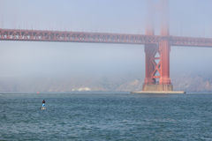 Stand up Paddle Boarder and Golden Gate Bridge Stock Image