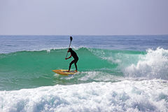 Stand up paddle boarding on the atlantic ocean. In Portugal Stock Image