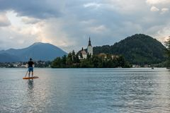 Stand up paddle boarding on the lake. Bled in Slovenia royalty free stock photo