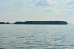 Stand up paddle boarding on the lake royalty free stock images