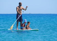 Stand Up Paddle Boards with kids Royalty Free Stock Photos