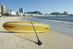 Stand Up Paddle Surfboard Copacabana Rio Brazil. Stand up paddle long board surfboard on Copacabana Beach Rio de Janeiro Brazil Royalty Free Stock Image