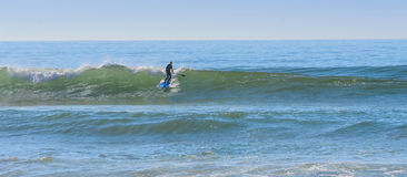 Stand up paddle Surfer at a surf break in morocco 2 Royalty Free Stock Image