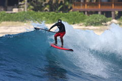 Stand Up Paddle surfing. Or SUP, is a new sport that is growing rapidly. Nelz Vellocido catches air at Makaha, Hawaii Stock Photos