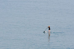 Stand up paddle surfing Stock Photos