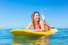 Stand Up Paddle Surfing In Hawaii. Attractive Young Woman Stand Up Paddle Surfing In Hawaii, Beautiful Tropical Ocean, Active Beach Lifestyle Stock Photos