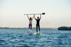 Stand up paddleboard beach people on paddle board Stock Photography