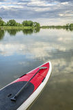 Stand up paddleboard on calm lake Royalty Free Stock Photos