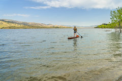 Stand up paddleboard on lake in Colorado Stock Images