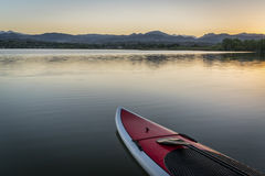 Stand up paddleboard on lake Stock Photos