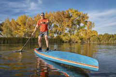 Stand up paddling in fall colors Stock Photography
