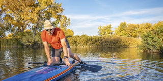 Stand up paddling in fall colors Royalty Free Stock Photography