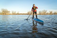 Stand up paddling on a lake in Colorado Stock Images
