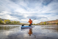 Stand up paddling on lake Stock Photos