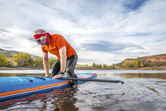 Stand up paddling on lake Stock Image