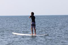 Stand Up Paddling Stock Image