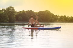 Stand up paddling SUP back yoga Royalty Free Stock Image