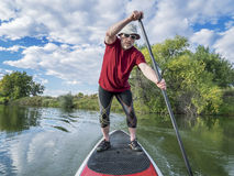 Stand up paddling - SUP Royalty Free Stock Photo
