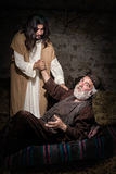 Stand up and walk said Jesus. Jesus healing the lame or crippled man Royalty Free Stock Photo