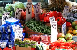 Vegetable stand in market. A stand with various fruits, vegetables and other produce on a market stock photography