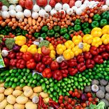 A stand with vegetables such as yellow pepper, beetroot, tomatoes, cucumber, pumpkin, carrots, radish, beetroot, garlic. royalty free stock photography