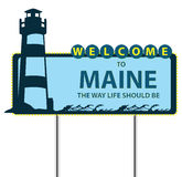 Stand Welcome to Maine. Road Stand Welcome to Maine, the lighthouse and the waves Royalty Free Stock Image