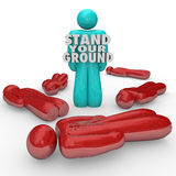 Stand Your Ground Words Person Standing Survivor Self Defense. A single person stands with words Stand Your Ground to illustrate self defense and sticking up for Stock Photography