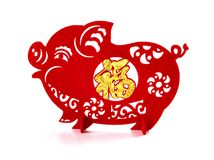 Standable paper-cut on white as symbol of Chinese New Year of the pig the Chinese means good luck stock image