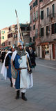 Standard bearer. Venice,Italy,February 26th 2011: Young man disguised as a medieval standard bearer marching in a costumes parade on Sestiere Castello in Venice Royalty Free Stock Image