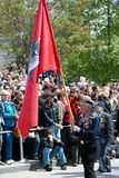 Standard bearer at russian veteran's parade. Royalty Free Stock Images