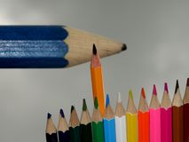 A Standard Carbon Tip Rises in front of a Large Blurred Pencil. stock image