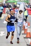 Standard Chartered Hong Kong Marathon 2017. Marathon; Citizen; BMW i3. The Timer Car on the Road Stock Photos