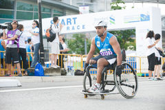Standard chartered marathon singapore 2010. Disabled athletes joining the standard chartered marathon in singapore on december 5, 2010 Royalty Free Stock Image