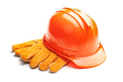 Standard construction safety equipment. A studio shot of a standard construction safety equipment, helmet and gloves,  on white background Stock Photos