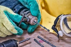 Standard construction safety equipment and Put a drill Royalty Free Stock Images