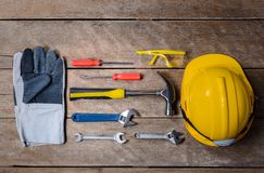 Standard construction safety equipment and tools set on wooden t. Standard construction safety equipment and tools set on old wooden background. top view, safety stock images