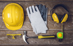 Standard construction safety equipment. And Tools on wooden table. top view Royalty Free Stock Photography
