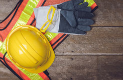 Standard construction safety equipment. On wooden table. top view Royalty Free Stock Photography