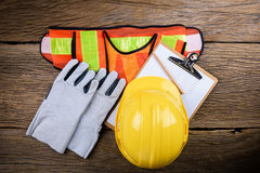 Standard construction safety equipment on wooden table. Top view Royalty Free Stock Image