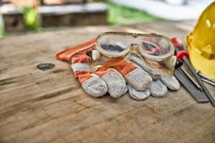 Standard construction safety equipment on wooden table stock images