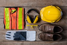 Standard construction safety equipment on wooden table. top view. Standard construction safety equipment on old wooden background. top view, safety first stock image