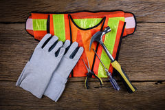 Standard construction safety equipment with work Tools on wooden Stock Photography