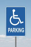 Standard Disabled Panking Sign with clouds. Standard disabled sign with clouds in the background Royalty Free Stock Photo